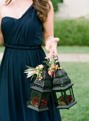 Lanterns used for bridesmaids to carry with floral accents. Alternative bridesmaid bouquets.