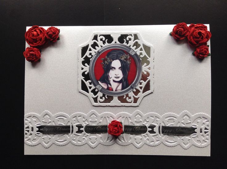 A simple but elegant gothic beauty Xmas card. Very happy with how the black and red stand out.