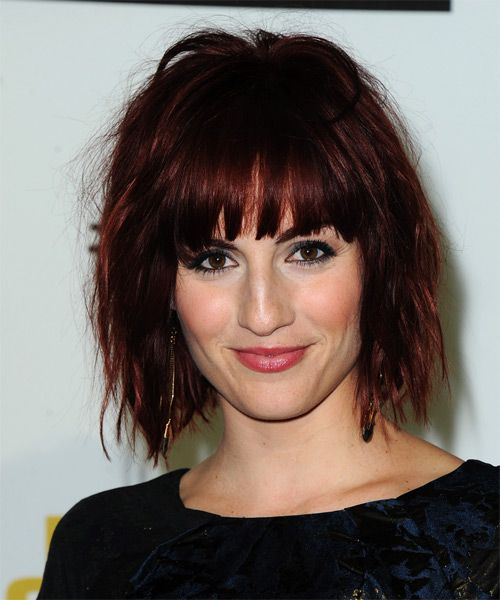 These dark red bob is jagged cut all through the length and layers to achieve a textured modern shape. The bangs are blunt cut to frame the top of the face and completes the over-all style magnificently. Regular trims is needed every 4-6 weeks to maintain style. Read more at http://www.thehairstyler.com/hairstyles/casual/medium/straight/alison-haislip#yVGFOUfkad4ibAlY.99