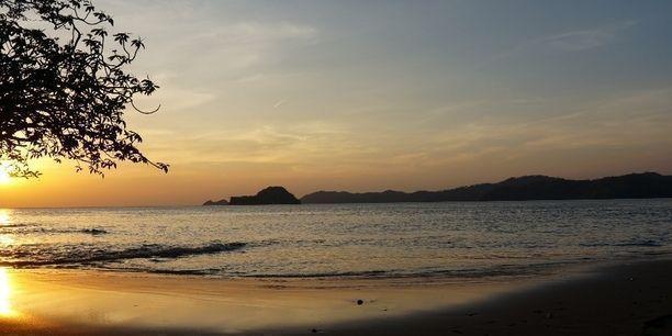 Junquillal Bay, Costa Rica, Guanacaste Province, Costa Rica — by Antonio and Amanda @ CYCLING EL MUNDO. Beautiful beach camping spot