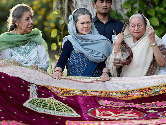 Congress President Sonia Gandhi with party leaders Mohsina Kidwai and Ambika Soni holding a 'chadar' before sending it for shrine
