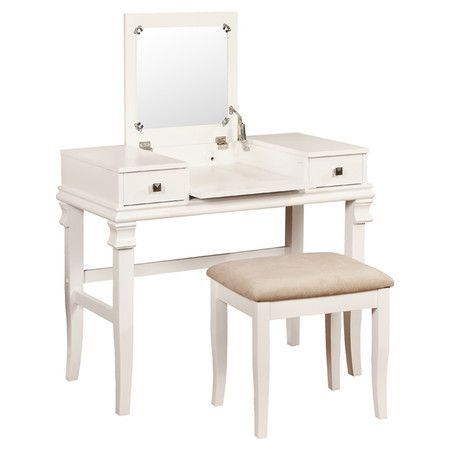 Try out new lipstick shades in front of this vanity's convenient folding mirror, then stow your standby cosmetics and accessories in its 2 drawers.