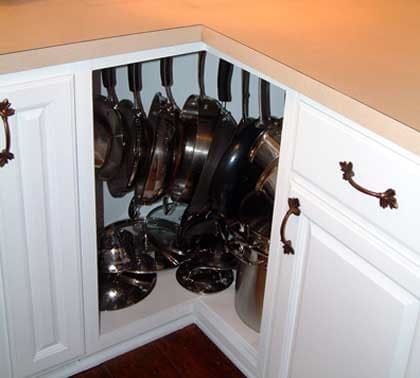 Corner cabinets can be a real drag, right? They're hard to reach into, they're dark, and often they just become a catch-all for underused kitchenwares. But check out this nifty project that turned a corner cabinet into the belle of the ball:
