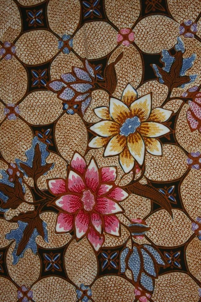 Detail of flowers on Hokokai Batik with Kawung pattern as the background. Full handrawn Indonesian Batik