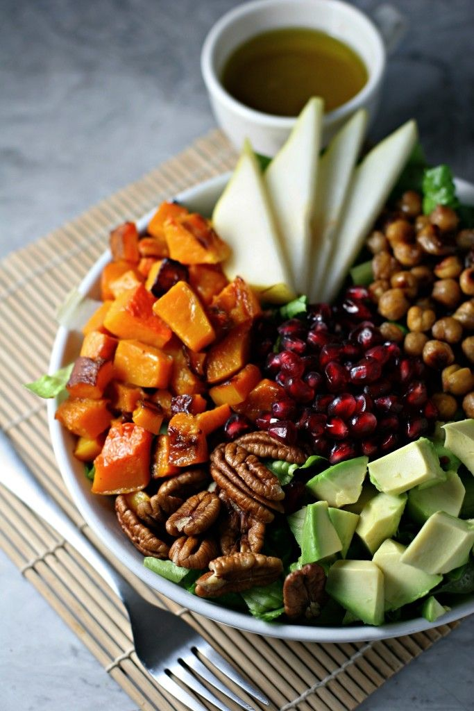 Winter Cobb Salad topped with cinnamon maple chickpeas, pears, pecans, avocado, pomegranate seeds and roasted butternut squash…vegan, gluten free