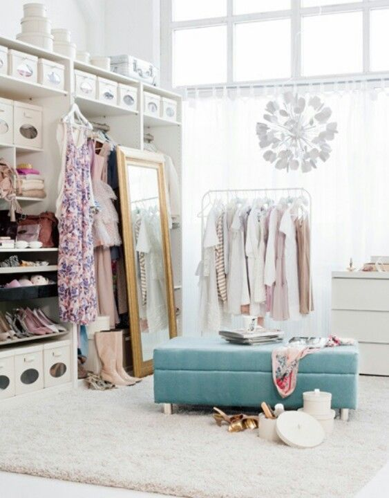 We love all white closet spaces, where clothes add the colour instead.