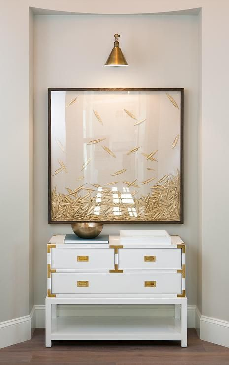 White and Gold Chest under Framed Art & Gray Walls with