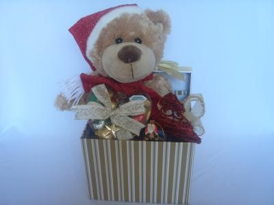 Includes a Brown Christmas bear with red hat & scarf, a box of Christmas chocolates, a heart box of Christmas coloured chocolates and a mini Santa box of chocs. Finished with Christmas ribbons, perfect for chocolate lovers.