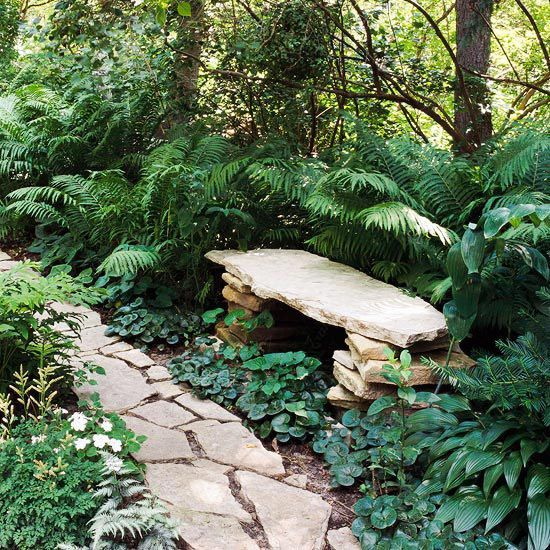 A stone bench in a cool, shady corner, so subtly incorporated into the landscape it appears as though it was placed by Mother Nature.