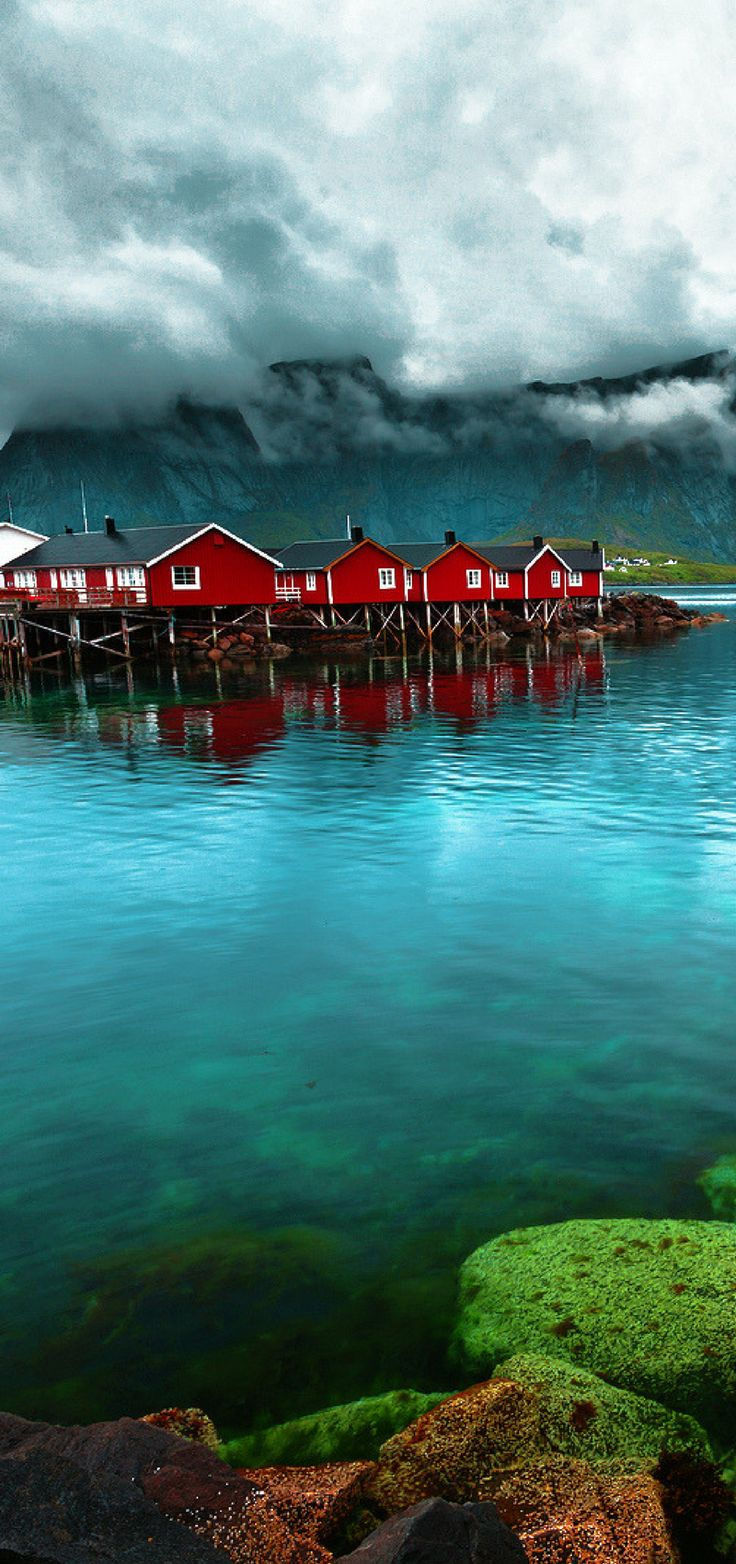 Reine, Lofoten Islands, Norway.  Whether you travel to Norway in the summer or winter you are sure to have the trip of your life!  Enjoy 20 incredible photos of Norway you can add to your bucket list! Fjords | Alesund | Flam | | Bergen | Nature | Waterfalls | Things to do in Norway