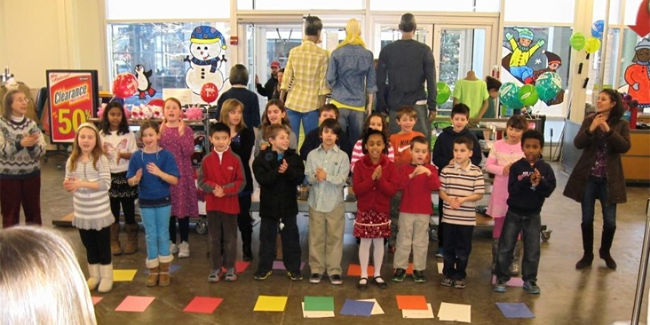 Applause, Applause!  FRCS students singing, serenading & spreading sunshine to shoppers @ Spanish Concert; @ Patriot Place Old Navy (January 2013)