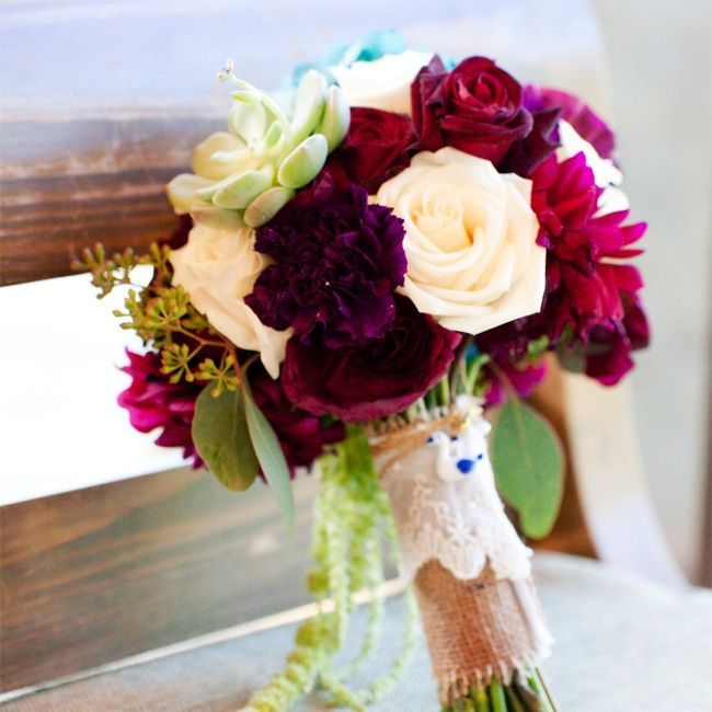 We're swooning over thisred and wine bouquet. Add some succulents and burlap for a truly stunning look.