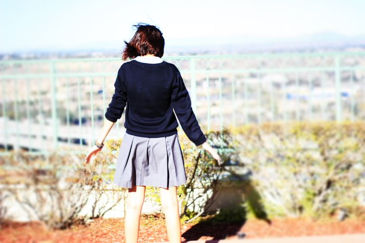 This picture was taken by my friend and classmate Naomi Cerda. It depicts me overlooking the valley with shrubbery in the background. This could be symbolic because of my isolation from the buildings/town in the picture. It can evoke feelings of beginning a journey or overcoming struggle, as well as having a nature element with the plants. It focuses on the individual rather than the masses in the buildings below.