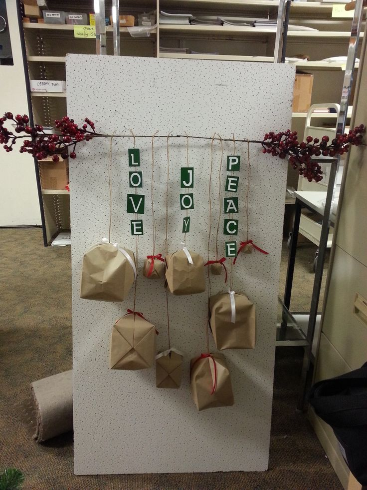 Christmas retail window hanging display.