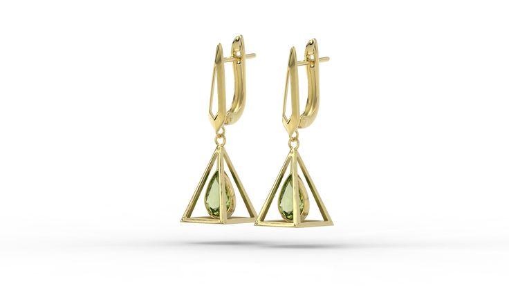 Złote geometryczne kolczyki z oliwinem. /Golden geometric earrings with olivine.