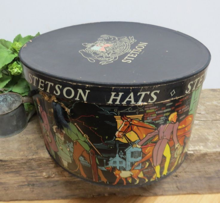 This is a beautiful Stetson hat box in black with colorful Victorian scenes running around the side. Description from etsy.com. I searched for this on bing.com/images