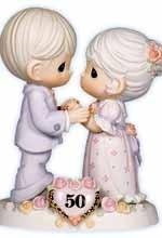 Precious Moments 50th anniversary cake topper -  will be looking for 1 of these in 48 years. :D