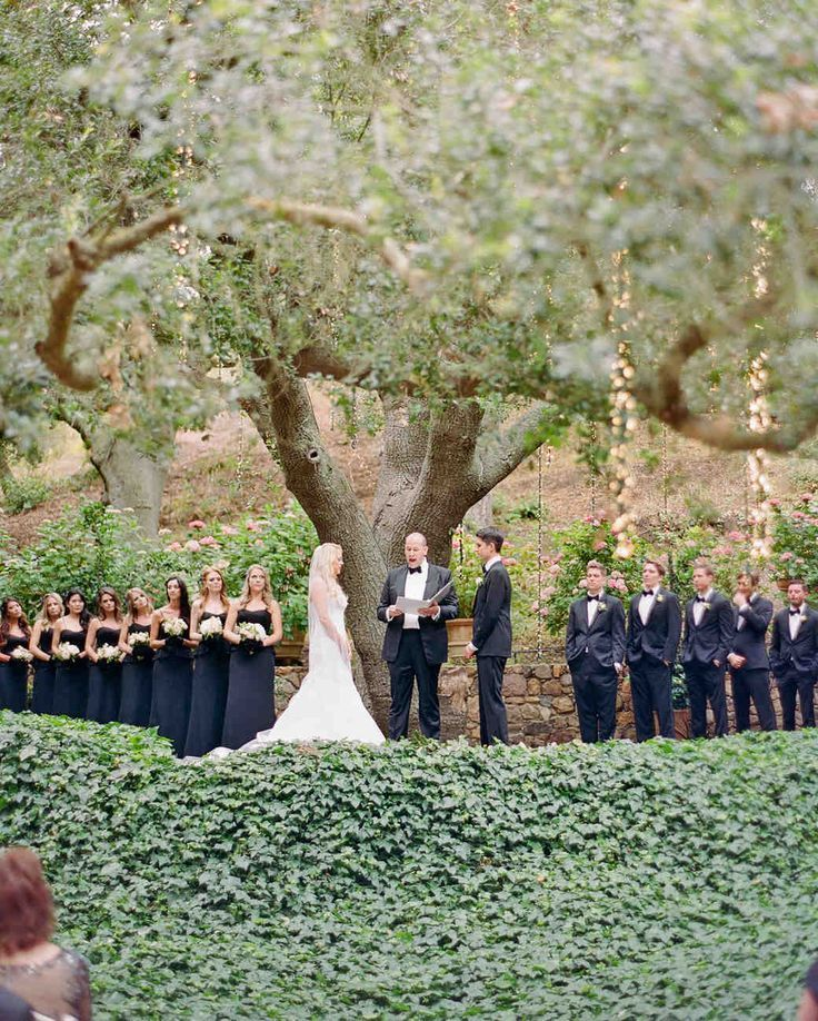 A Whimsical Malibu Wedding Inspired by the Greatest Love Stories | Martha Stewart Weddings - Shannon and Jon were married under a hundred-year-old oak tree. With fairy lights trailing down the branches and peeking through the leaves, the ceremony looked like a scene straight out of Shakespeare's Midsummer Night's Dream.