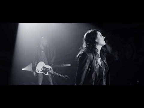 Within Temptation - Shot In The Dark.  I just love this woman with all my heart. The hottest Dutch singer in the world: Sharon Den Adel.