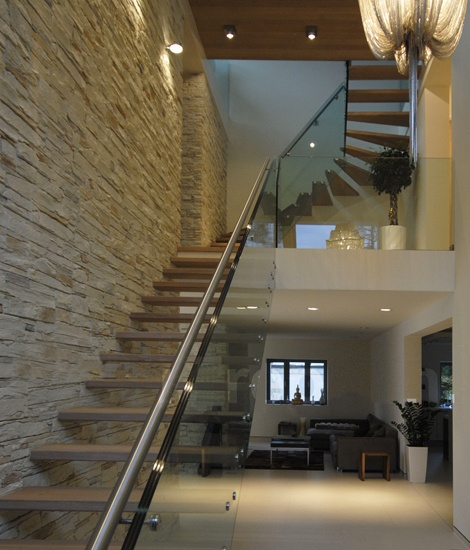 wooden cantilevered stairs with glass ballastrade & alu handrail
