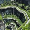 WOHA Architects' Park Royal Hotel in Singapore showed a building  with gardens, water features and green pathways. The lush urban oasis features cascading planter terraces and waterfalls, creating an almost otherworldly botanical microcosm in the midst of busy Singapore.  http://inhabitat.com/park-royal-tower-wohas-stunning-vertical-urban-park-opens-in-singapore/parkroyal-singapore-woha-architects-12/?extend=1