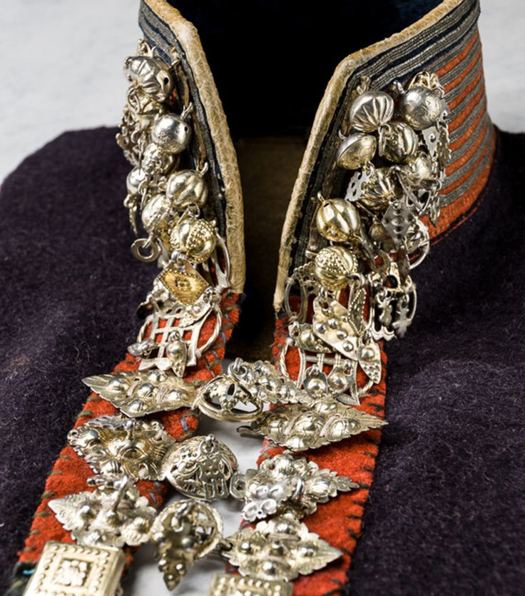 In the Sami culture, silver jewellery was an important investment, but it was also believed to be loaded with magic and symbolism. A 'silver collar' forms part of the traditional woman's costume for weddings and celebrations.  This sami silver collar decorated with lacing rings, buttons and clasps was used in Senjen, Tromsö, Norway, in the early 19th century. Photo: Mats Landin, Nordiska museet, CC-BY-NC-ND.