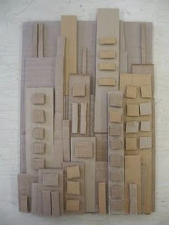 cardboard cityscape- good way to use scraps. paint a few pieces of cardboard before they cut out the shapes and windows