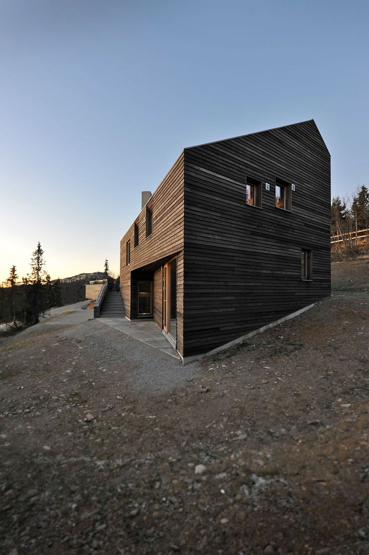 """Norwegian architectural firm JVA has created the Twisted Cabin. Completed in 2011, this 3,875 square foot contemporary home is located in Kvitfjell, Norway. Twisted Cabin by JVA: """"High in the mountain, 1000m above the ocean and close to the ski slopes, the cabin reflects the contours in the terrain to make room for a large family on holiday. The cabin has seven floor levels connected differently to the surrounding terrain..."""
