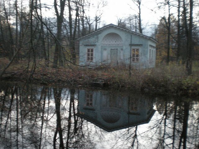 """Small house on """"Children's Island"""" with the grounds of the Imperial park in Tsarskoe Selo. Built in 1830 and played in by Romanov children up to and including the children of Tsar Nicholas II who would row boats to the island."""