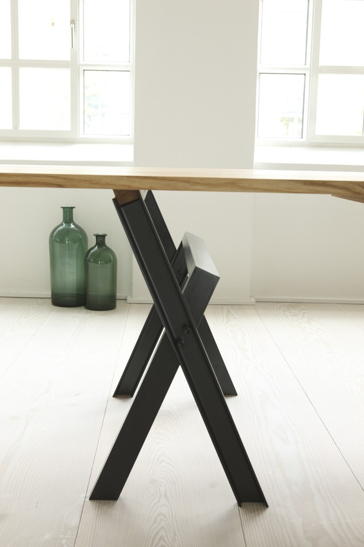 """""""THE NEVER ENDING TABLE""""   In search of a trestle as the frame for carrying these potentially huge wooden table tops, we came across Søren Ulrik Petersen's characteristic wood trestle """"Lambda"""".We asked the talented designer to consider reworking the design into a metal version for us. """"the never ending table"""" is the result of which we are proud."""