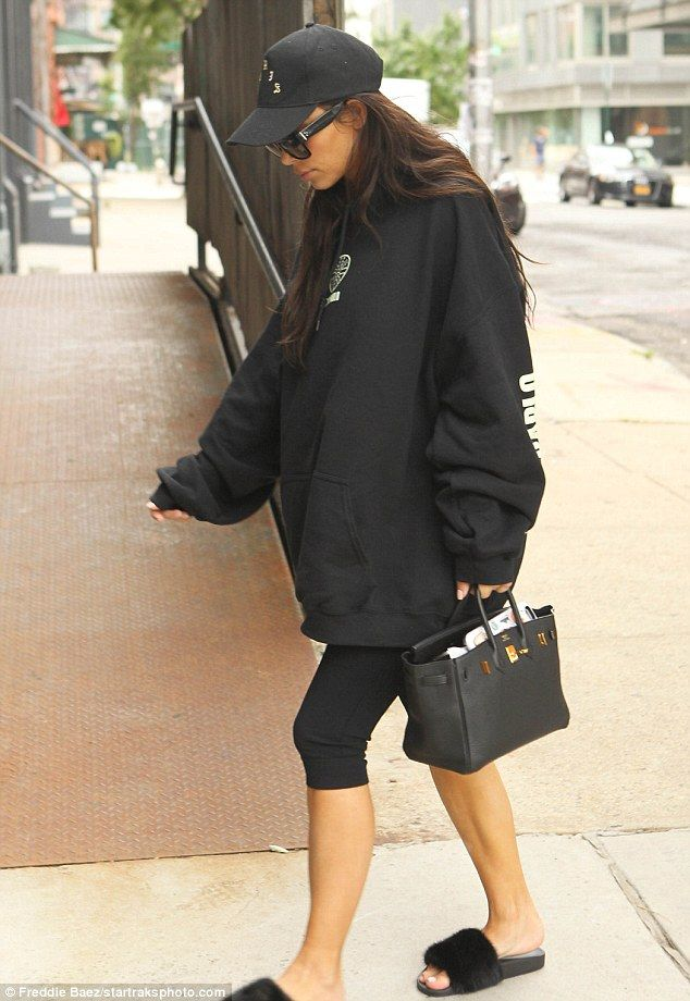 Laid-back: The mother-of-two looked comfortable as she coupled the over-sized sweatshirt with skintight, black leggings and fuzzy, slip-on sandals