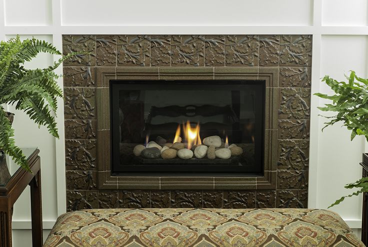 This gorgeous fireplace surround was created with for Prairie style fireplace