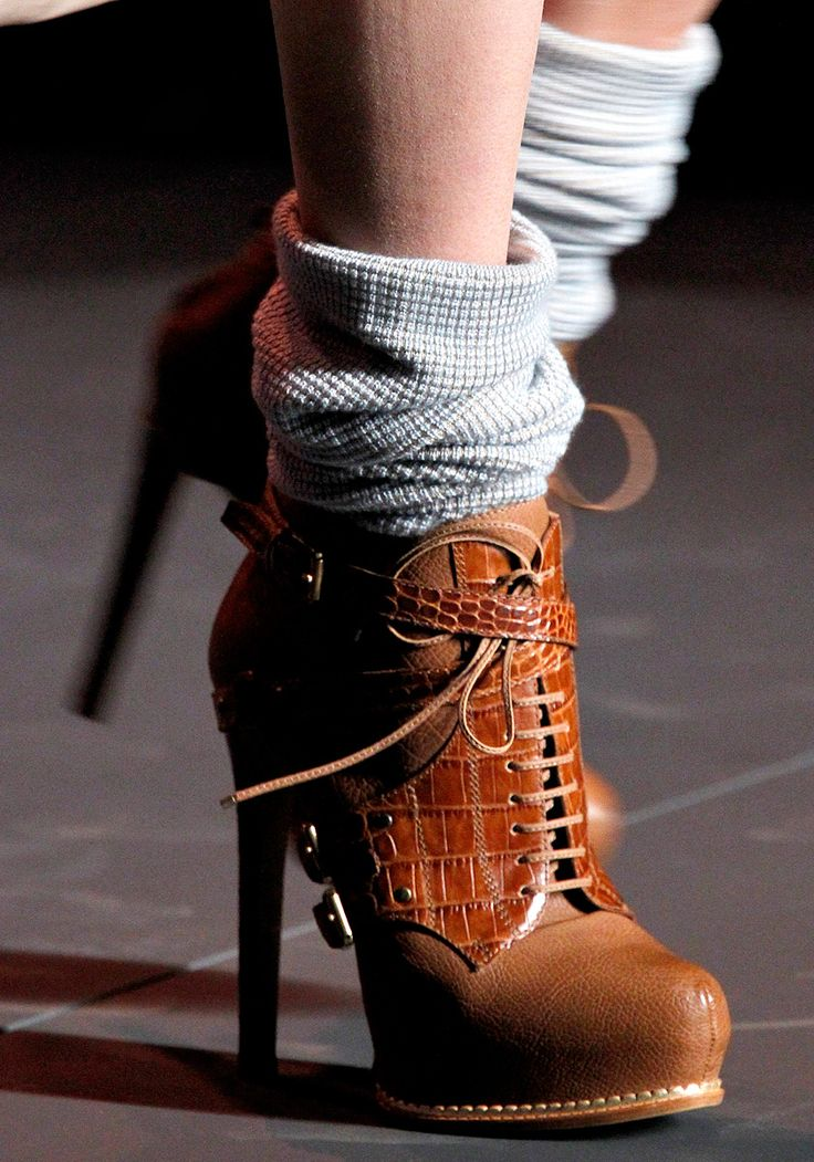 Slouchy socks + high heeled boots. I like something about this...but would it work in real life?