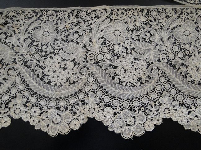 My choice for best lace in the 6/23/13 Ebay Alerts. A wide later 19th c flounce of Duchesse de Bruges.