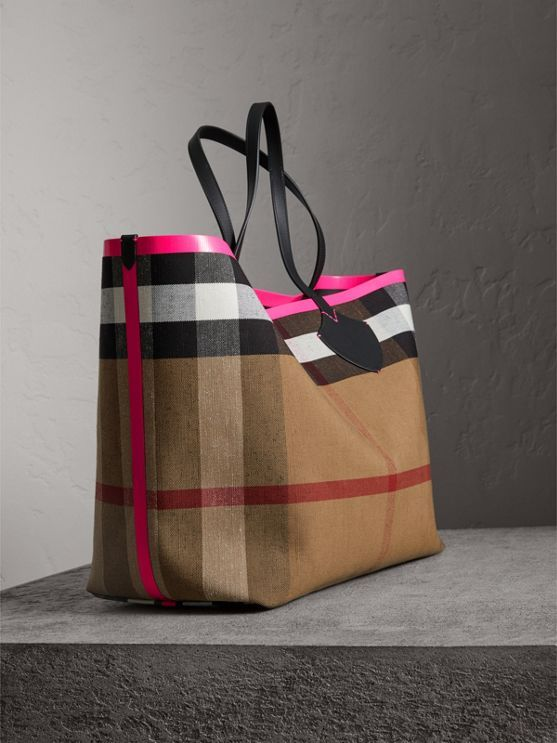 4b47eebb9587 A supersized reversible tote in supple leather bonded to Canvas check. Neon  sealed seams add a clash of colour to the unisex bag.
