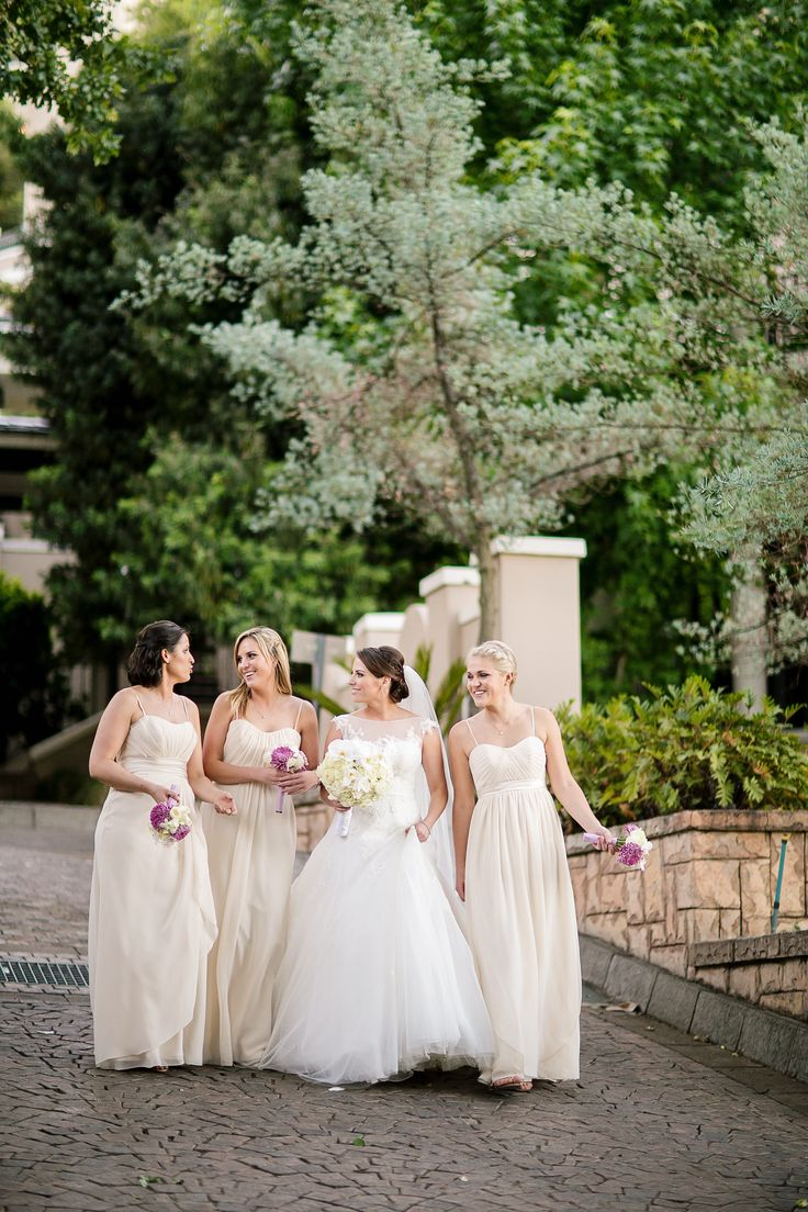 Elegant wedding. Cream bridesmaid dresses. White and purple wedding. Four Seasons Hotel. Image by Tyme Photography