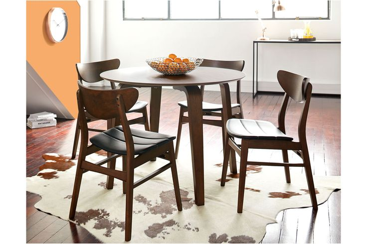 The Brady 5 Piece Dining Suite is a charming dining suite. It features a round dining table with stunning legs and 4 chairs.