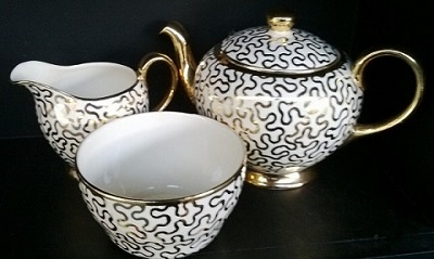 Crown Lynn Doris Bird gold lustred elegant teaset, I know a rest home that has this in its china cabinet !