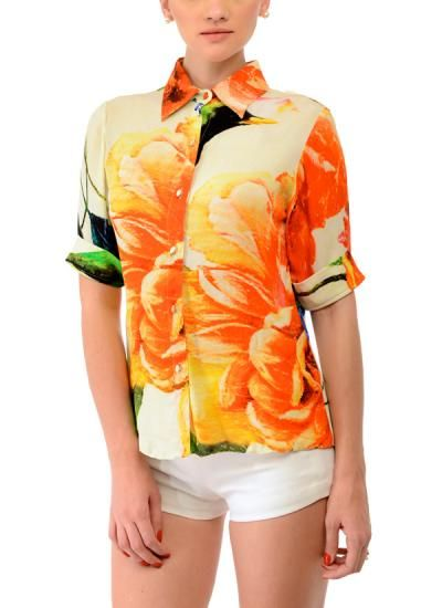 Turn up smart and trendy in this multi-coloured shirt by Swatee Singh available at strandofsilk.com. This shirt with three quarter sleeves features a vivacious orange floral print on the front and a large bird print at the back. The button down shirt with its vibrant colours is ideal for the day when worn with a pair of trousers or shorts! #smart #trendy #swateesingh #shirt #vivacious #orange #floral #print #vibrant