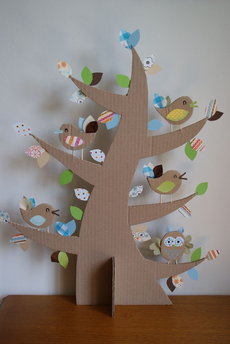 Cardboard tree with cardboard birds and paper leaves