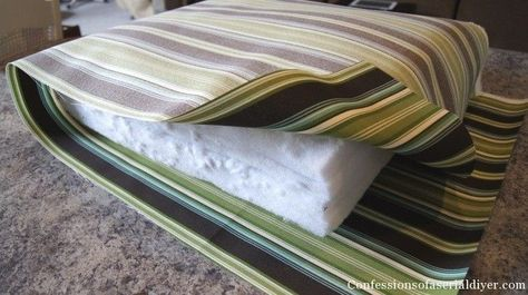 DIY cushions for patio furniture. Super easy. I didn't have old cushions to cover so I used layers of cheap bed padding foam wrapped in batting. Look here for how to do boxed corners that are not covered well http://craftapple.wordpress.com/2007/09/01/sewing-tip-squarely-boxing-those-corners/