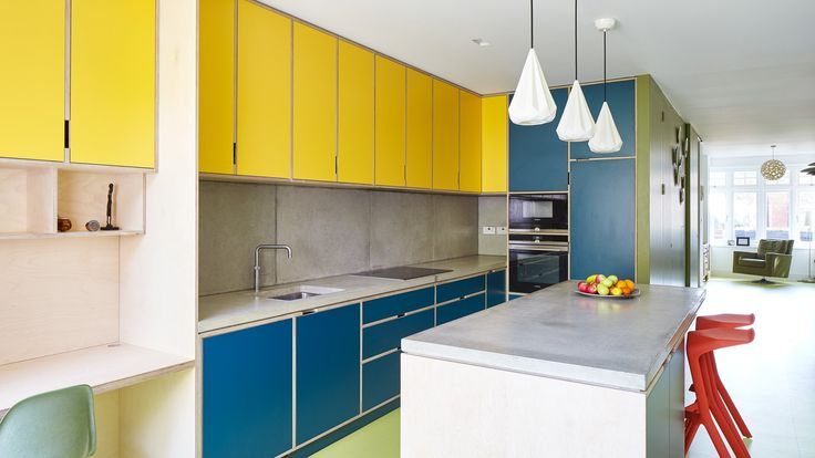 This terraced family home in southeast London has been brightened up with a colourful open-plan living space and a loft extension offering rooftop views.