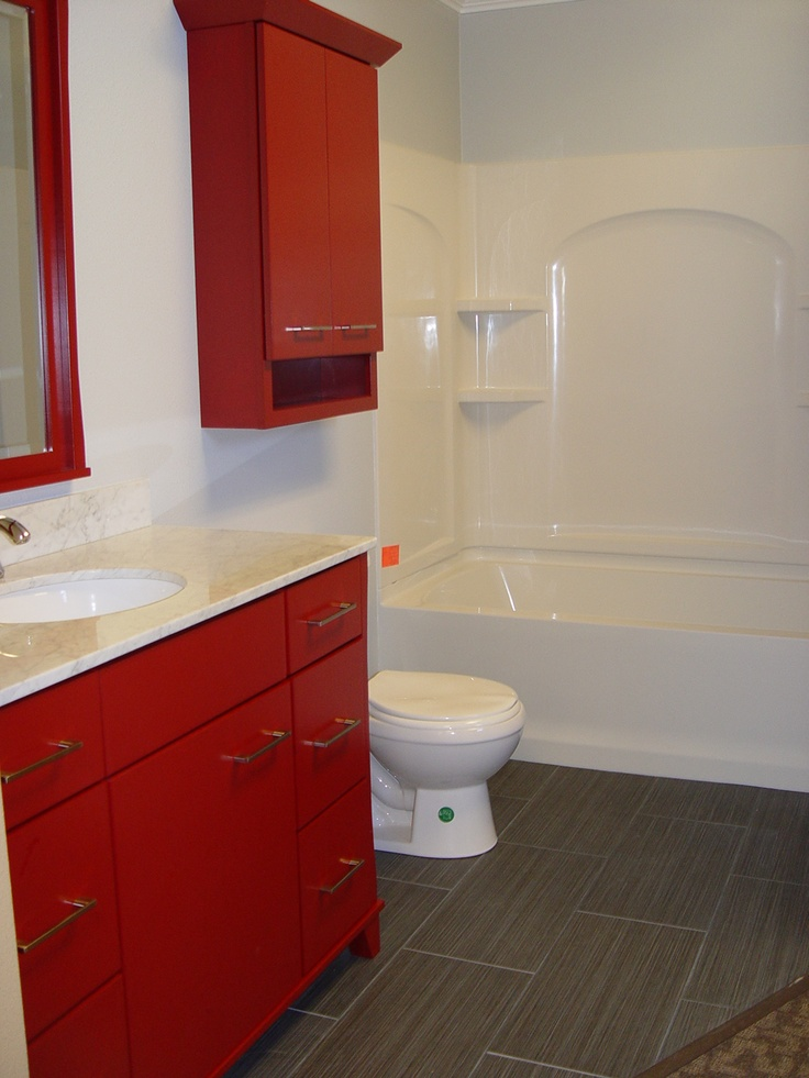 Cabinetry and the color is Cardinal Red  shower surround by Sterling