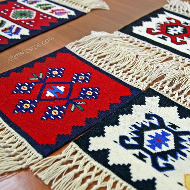 Small pieces of Pirot kilim (about 30cm), used as souvenirs. Pirot kilim is a unique and highly regarded brand of flat tapestry-woven carpets or rugs, made of pure sheep's wool ( from Stara Planina, southeastern Serbia), dyed with natural colours and long enduring. Has 25 weaves in 1cm and both sides of the rug can be used. Its ornaments are unique: 96 of them are geographically protected exclusively made in Pirot, Serbia.