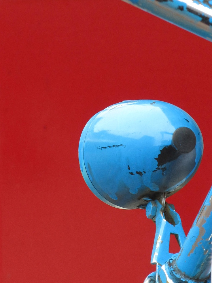 Blue bike against a red background.