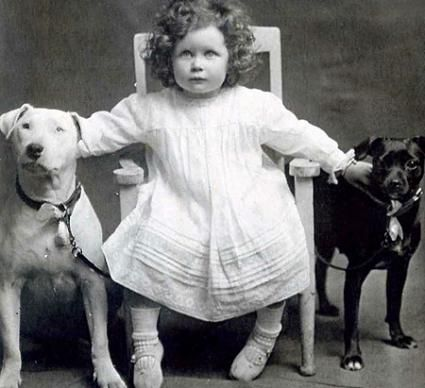 "We have no info on this Victorian trio, but we just love her ""girl in charge"" attitude. Maybe she grew up to be a dog trainer?"