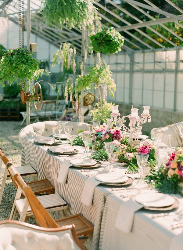 greenhouse setting, black and cream pinstripe table covers...