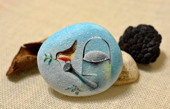 Painted stone, sasso dipinto a mano. Bird on watering