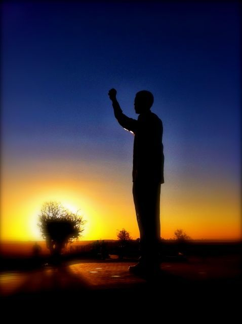 Nelson Mandela statue, Bloemfontein, South Africa, at sunset.