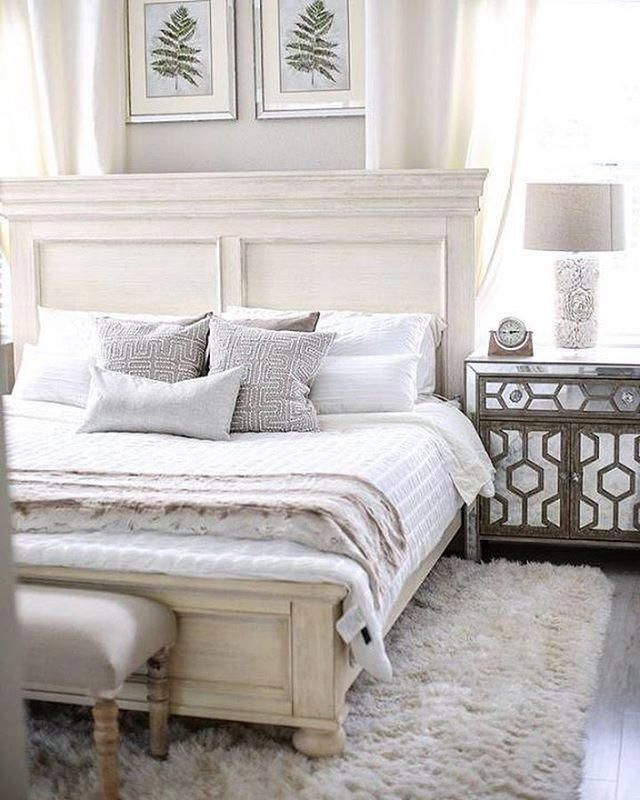 622fe4c71f6e A small master bedroom with a white bed with white linens and a white  shaggy rug